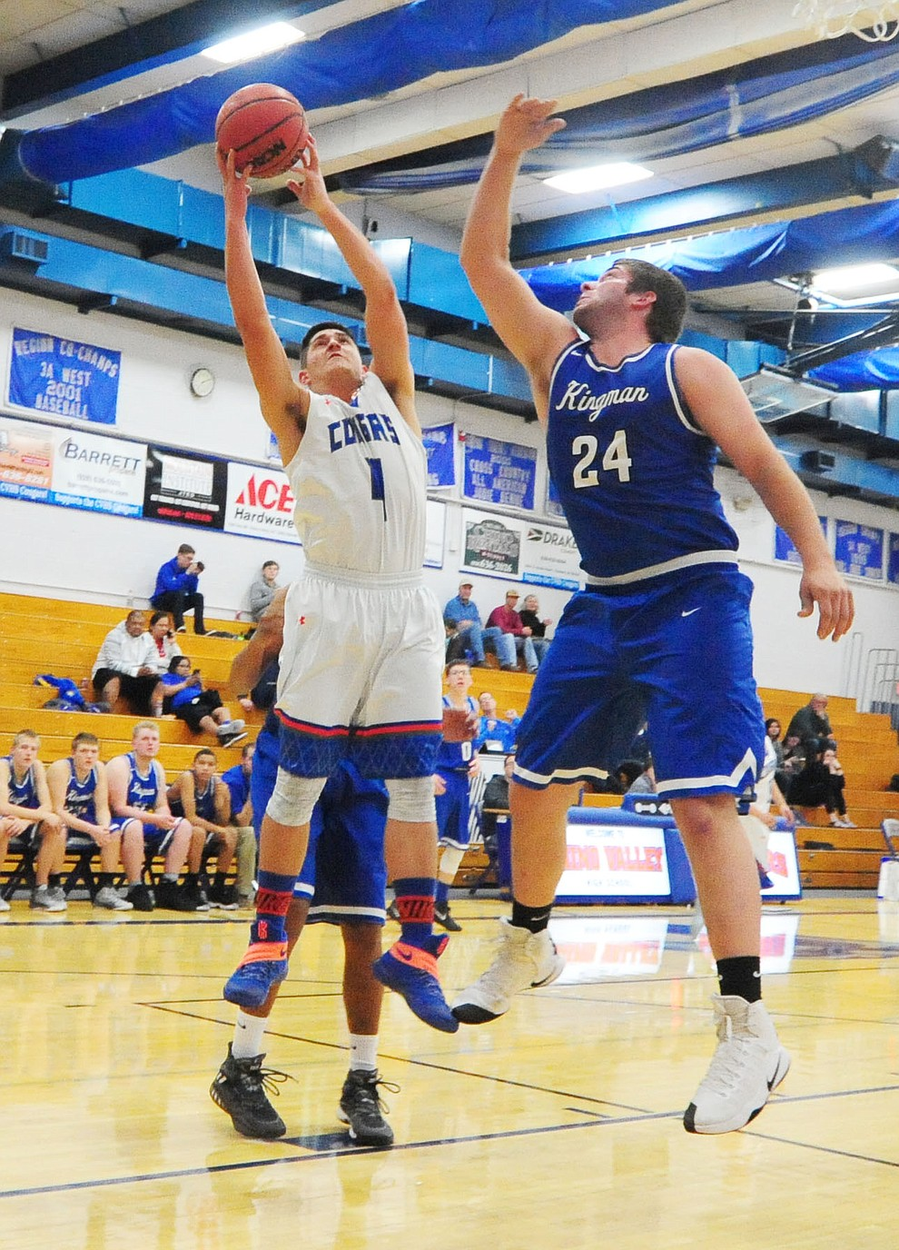Chino Valley's Jaydon Loftin gets a shot off in the paint as the Cougars take on the Kingman Bulldogs Tuesday, January 10 in Chino Vallley. (Les Stukenberg/The Daily Courier)