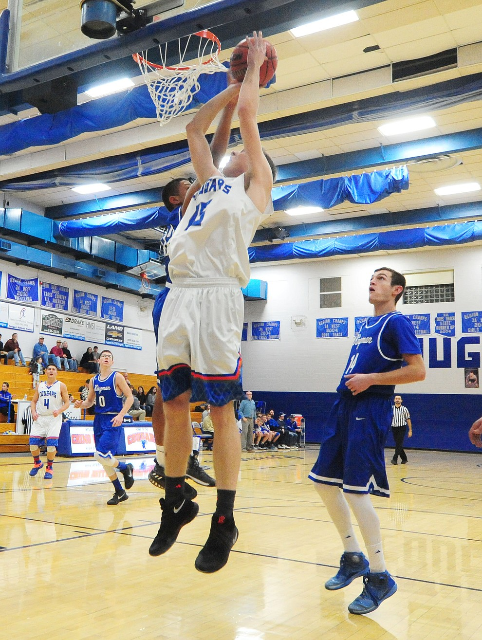 Chino Valley's Gavin Cluff goes to the hoop as the Cougars take on the Kingman Bulldogs Tuesday, January 10 in Chino Vallley. (Les Stukenberg/The Daily Courier)