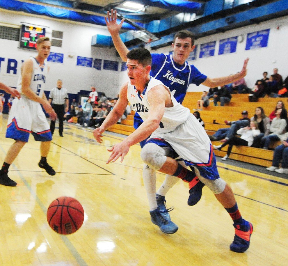 Chino Valley's Jaydon Loftin moves the ball along the baseline as the Cougars take on the Kingman Bulldogs Tuesday, January 10 in Chino Vallley. (Les Stukenberg/The Daily Courier)