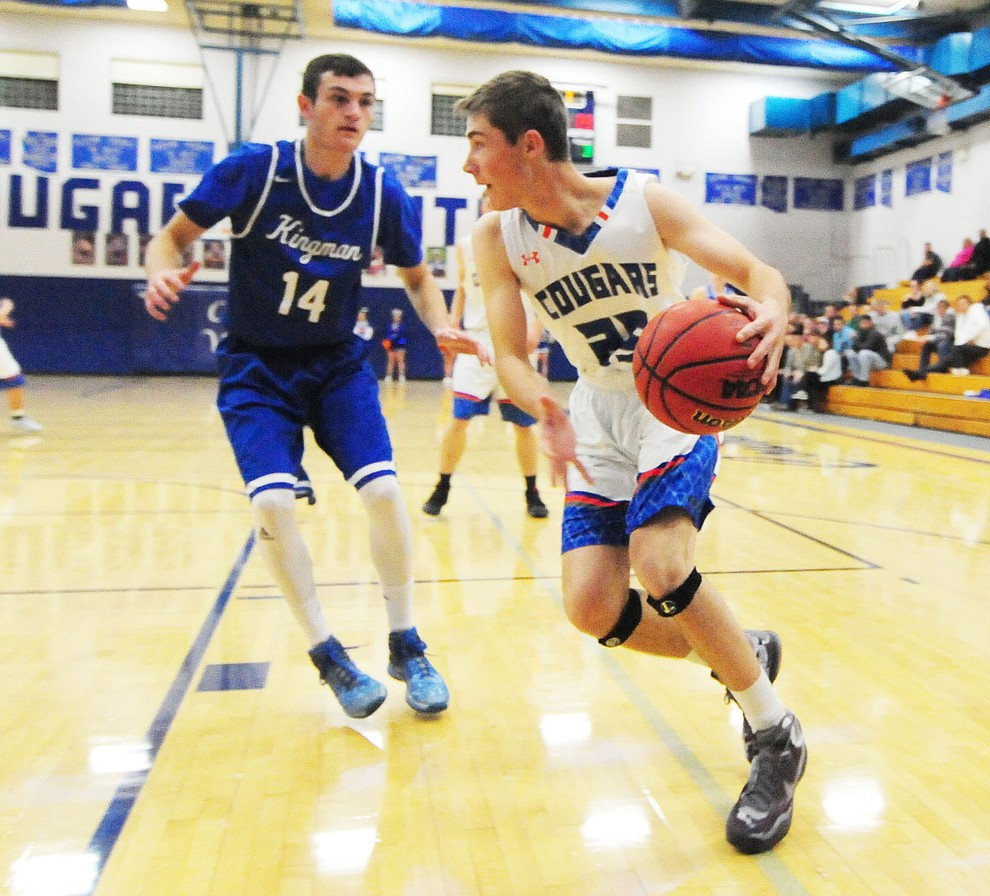 Chino Valley's Blake Ely looks to pass as the Cougars take on the Kingman Bulldogs Tuesday, January 10 in Chino Vallley. (Les Stukenberg/The Daily Courier)