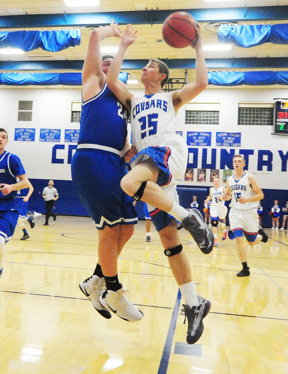 Chino Valley's Blake ELy goes up hard as the Cougars take on the Kingman Bulldogs Tuesday, January 10 in Chino Vallley. (Les Stukenberg/The Daily Courier)