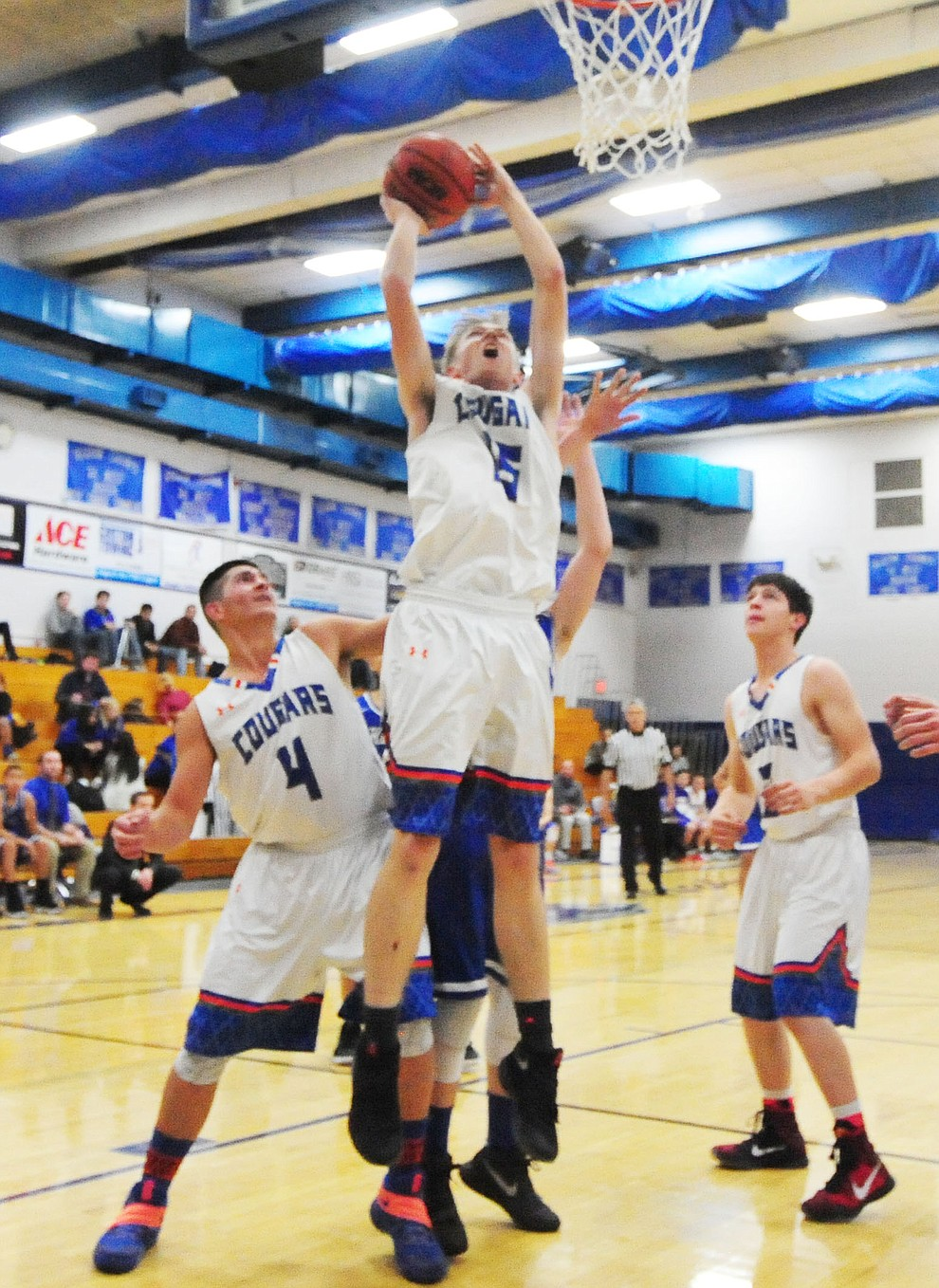 Chino Valley's Gavin Cluff gets inside position as the Cougars take on the Kingman Bulldogs Tuesday, January 10 in Chino Vallley. (Les Stukenberg/The Daily Courier)