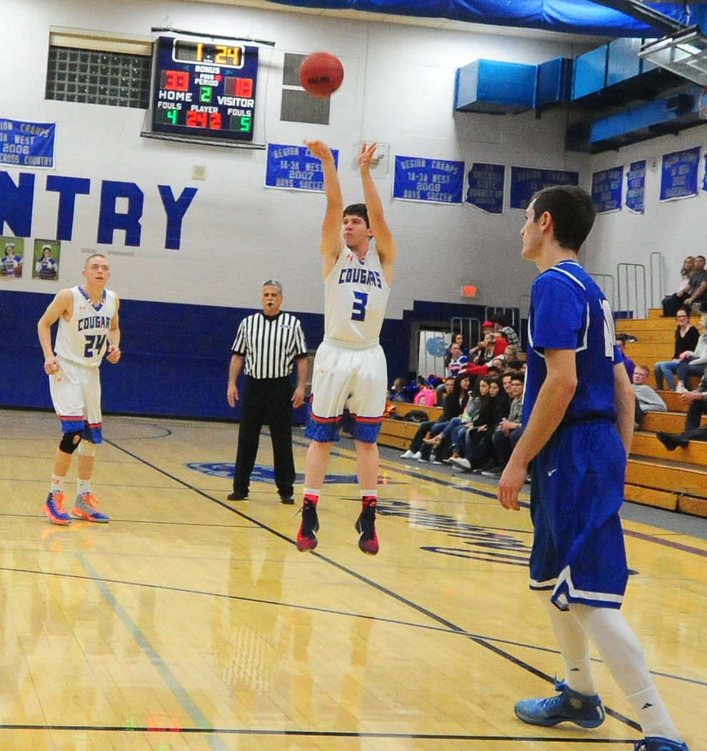 Chino Valley's Tyler Hixon launches a 3-pointer as the Cougars take on the Kingman Bulldogs Tuesday, January 10 in Chino Vallley. (Les Stukenberg/The Daily Courier)