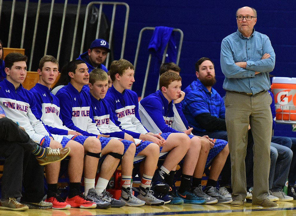 Chino Valley Head Coach Mike Fogel watches the action as the Cougars take on the Kingman Bulldogs Tuesday, January 10 in Chino Vallley. (Les Stukenberg/The Daily Courier)