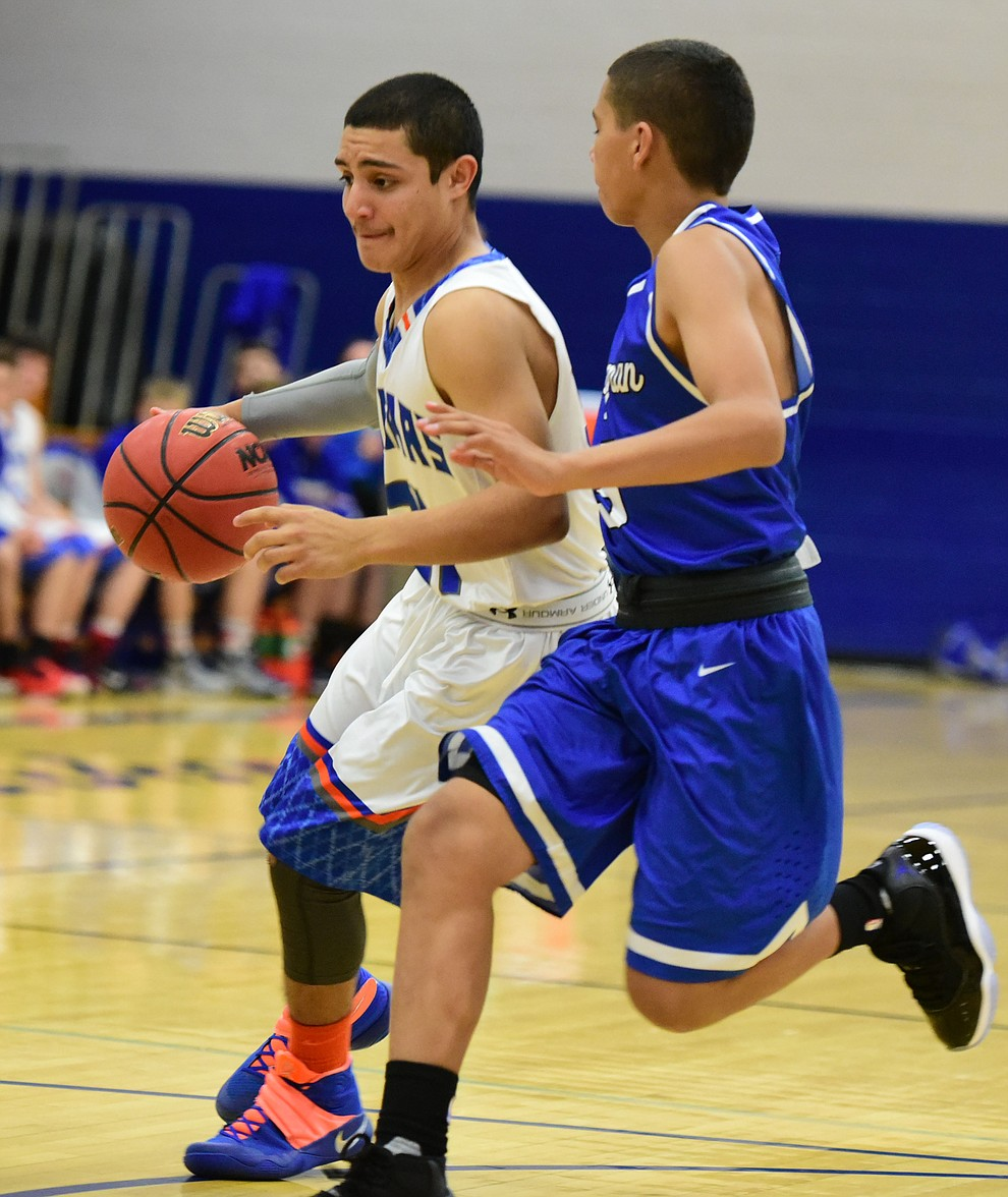 Chino Valley's Andrew Granillo dribbles upcourt as the Cougars take on the Kingman Bulldogs Tuesday, January 10 in Chino Vallley. (Les Stukenberg/The Daily Courier)