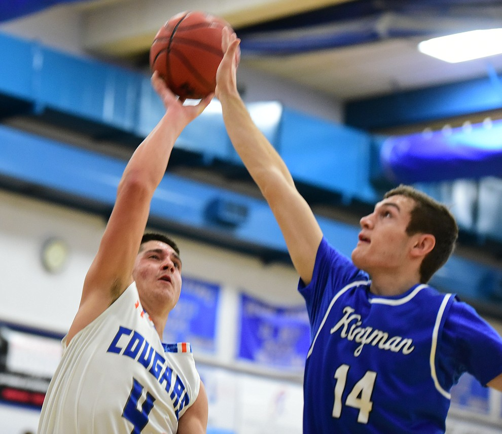 Chino Valley's Jaydon Loftin tries to get a shot off as the Cougars take on the Kingman Bulldogs Tuesday, January 10 in Chino Vallley. (Les Stukenberg/The Daily Courier)