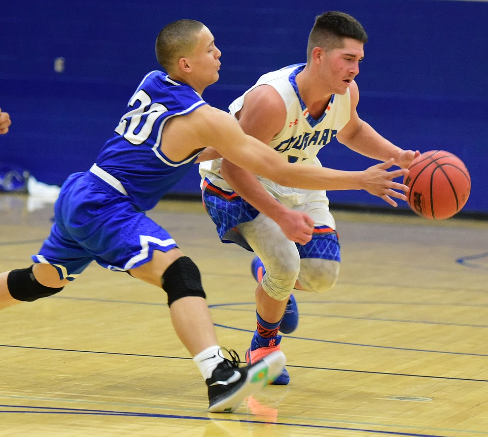 Chino Valley's Jaydon Loftin dribbles upcourt as the Cougars take on the Kingman Bulldogs Tuesday, January 10 in Chino Vallley. (Les Stukenberg/The Daily Courier)