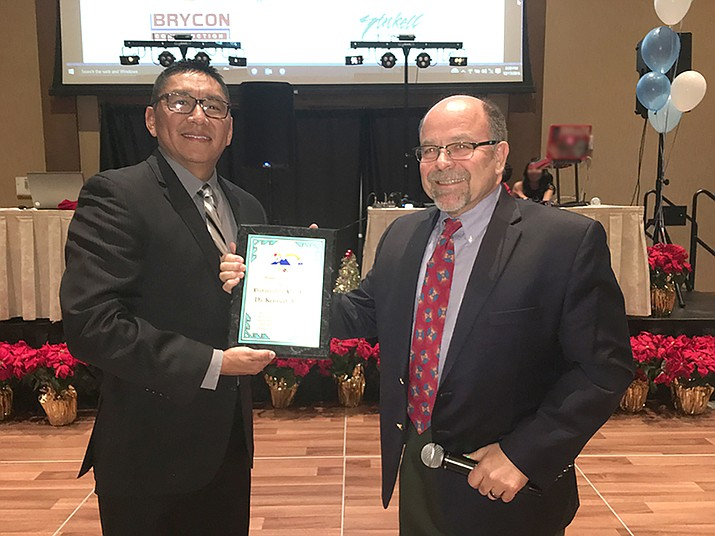 Oral and maxillofacial physician Dr. Kenneth Moran is presented the 2016 Drouhard Provider of the Year award by the Navajo Hopi Health Foundation. Moran was recognized for his dedication to his community and patients. Submitted photo