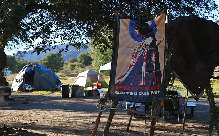 Members of the San Carlos Apache Tribe set up a camp near the entrance of Oak Flat campground near Superior, Arizona showing they oppose a proposed copper mine. Photo/Bri Cossavella, Cronkite News