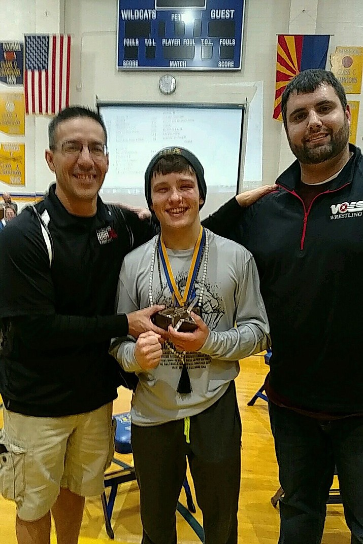 Assistant coach Ray Sanchez Nic Verville and Head coach Dan Ondrejka, together after Verville was named Outstanding Wrestler in the Joseph City Invitational.
