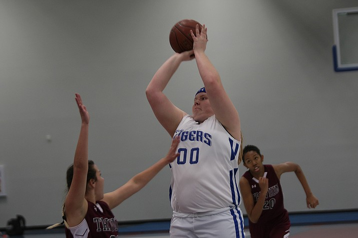 Kingman Academy's Kiersten Edwards takes a jumper against Trivium Prep in Friday night's 38-22 victory.