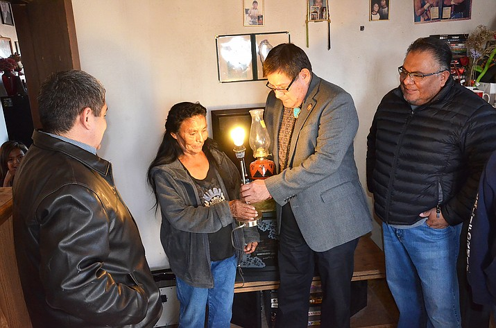 Navajo Nation Council Speaker LoRenzo Bates visits the home of Modesta Jones after Big Navajo Energy installed solar and wind energy to the home. Submitted photo