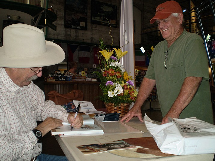 Bob Boze Bell signs his book for an admirer.