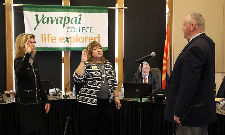 Yavapai District Governing Board members Connie Harris, left, and Deb McCasland are sworn in by Yavapai County School Superintendent Tim Carter.