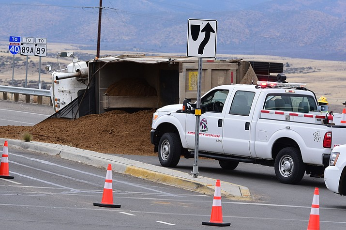A dump truck rolled over on the turn from Highway 69 onto Fain Road in Prescott Valley Thursday afternoon. Traffic backed up on Highway 69 westbound and the exit was blocked while crews righted the truck and cleaned the dirt from the roadway.