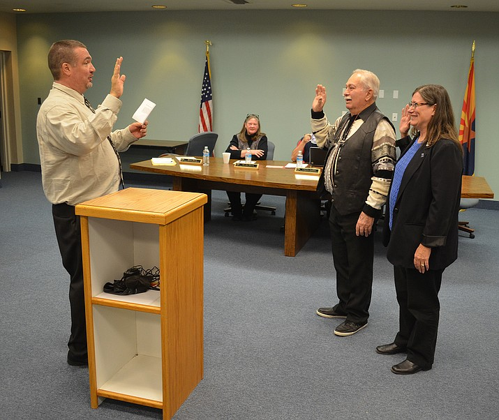 Mohave County School Superintendent Mike File (left) gives the oath of office to Kingman Unified School district Governing Board member Bruce Ricca, who was re-elected, and new member Beth Weisser.