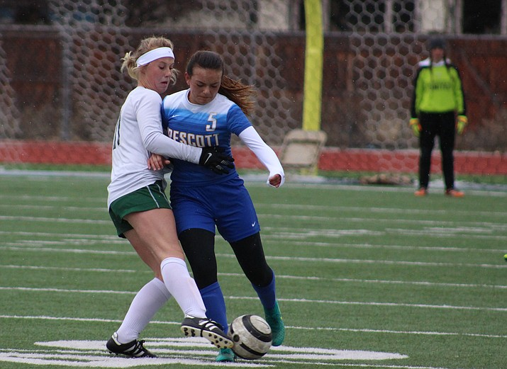 Prescott's Sydney Seeley (5) attempts to steal the ball from an Eagles player Thursday afternoon in Flagstaff. The Badgers lost 2-0. (Cody Bashore/Daily Sun, Courtesy)