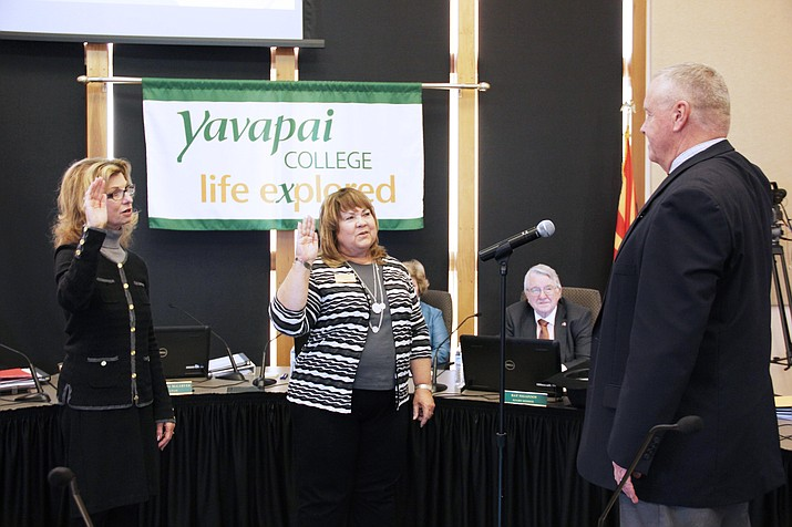 Yavapai District Governing Board members Connie Harris, left, and Deb McCasland are sworn in by Yavapai County School Superintendent Tim Carter. (Photo by Max Efrein)
