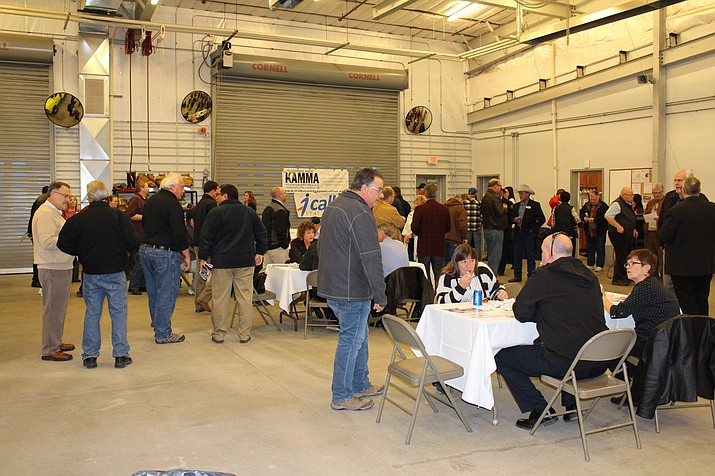The Kingman and Mohave Manufacturing Association mixer Thursday at Kingman Airport Authority drew about 75 people, including city officials and representatives of companies based at Kingman Airport and Industrial Park.