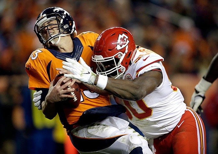 In this Nov. 27, 2016, file photo, Kansas City Chiefs outside linebacker Justin Houston (50) sacks Denver Broncos quarterback Trevor Siemian (13) in the end zone for a safety during the first half of an NFL football game, in Denver.