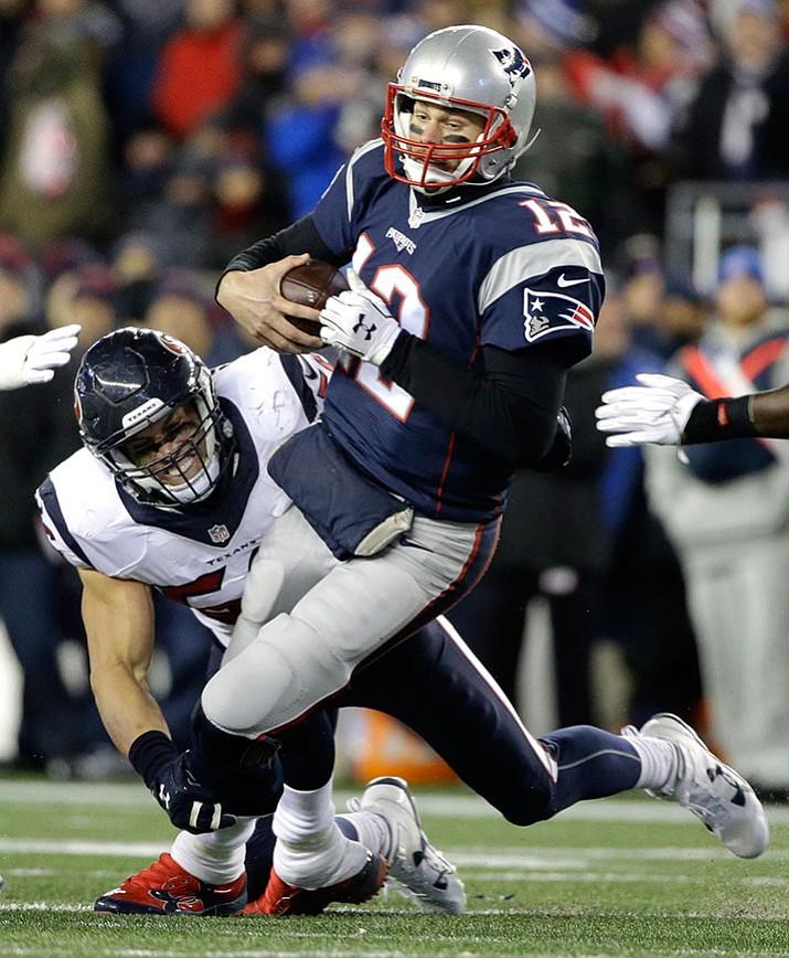Texans linebacker Brian Cushing sacks Patriots quarterback Tom Brady during their  divisional playoff game, Saturday, Jan. 14, in Foxborough, Mass.