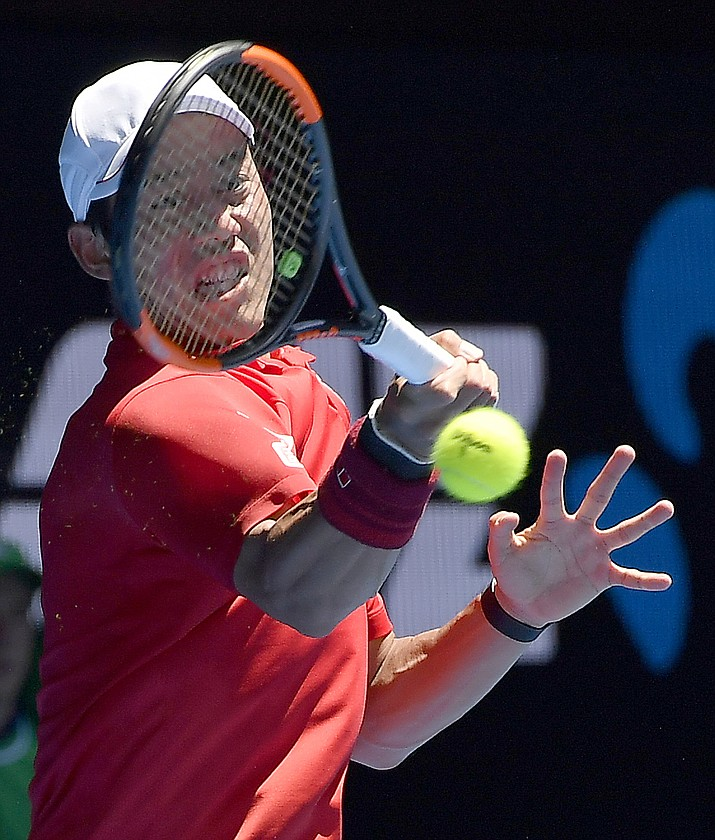 Japan's Kei Nishikori hits a forehand to Russia's Andrey Kuznetsov during their first round match at the Australian Open tennis championships in Melbourne, Australia, Monday, Jan. 16, 2017. (AP Photo/Andy Brownbill)