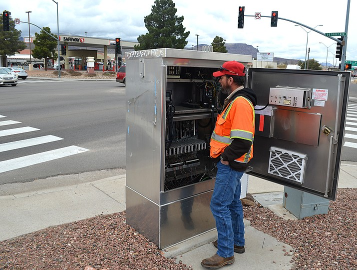 Walter Davis, city traffic signal technician, monitors a computer inside a traffic signal cabinet for timing and functionality. Despite what it feels like, no light under the city's control stays red for more than two minutes.