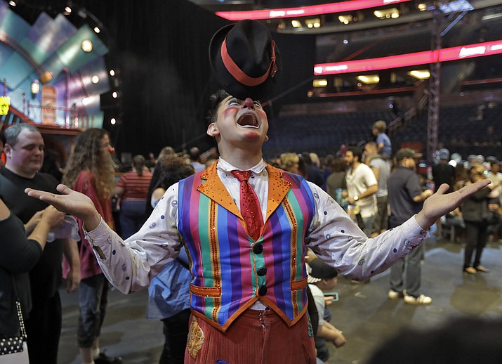 "A Ringling Bros. and Barnum & Bailey clown balances a hat on his nose during a pre show for fans Saturday, Jan. 14, 2017, in Orlando, Fla. The Ringling Bros. and Barnum & Bailey Circus will end the ""The Greatest Show on Earth"" in May, following a 146-year run of performances."
