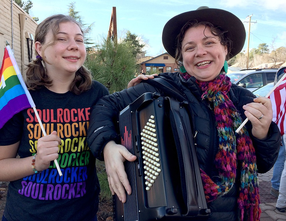 Sue Tone/The Daily Courier.Two of three generations planning to attend the Women's March on Washington in Washington, D.C., also took part in Prescott's Martin Luther King, Jr., March on Jan. 16. Meg Bohrman, right, provided music and freedom songs, with daughter, Opal, 14.