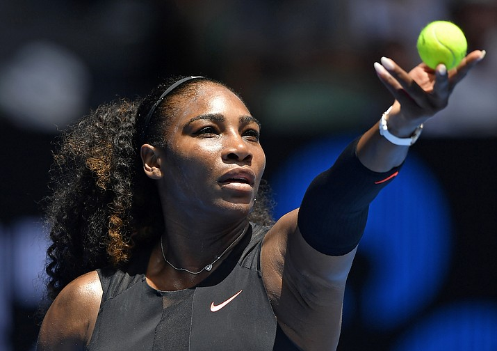 United States' Serena Williams prepares to serve to Switzerland's Belinda Bencic during their first round match at the Australian Open tennis championships in Melbourne, Australia, Tuesday, Jan. 17, 2017. (Andy Brownbill/Associated Press)