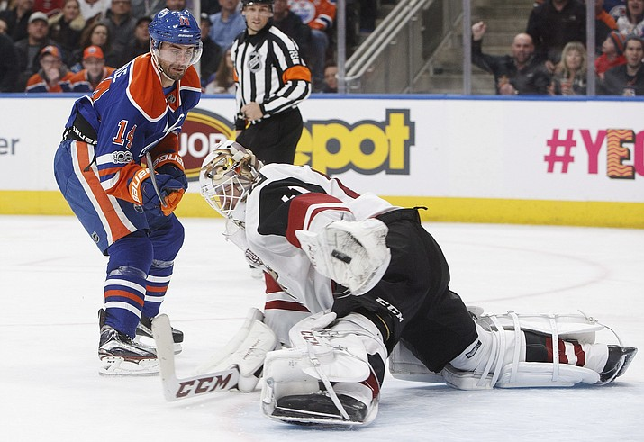 Arizona Coyotes goalie Mike Smith (41) makes the save on Edmonton Oilers' Jordan Eberle (14) during second period Monday in Edmonton, Alberta. (Jason Franson/The Canadian Press, via AP)