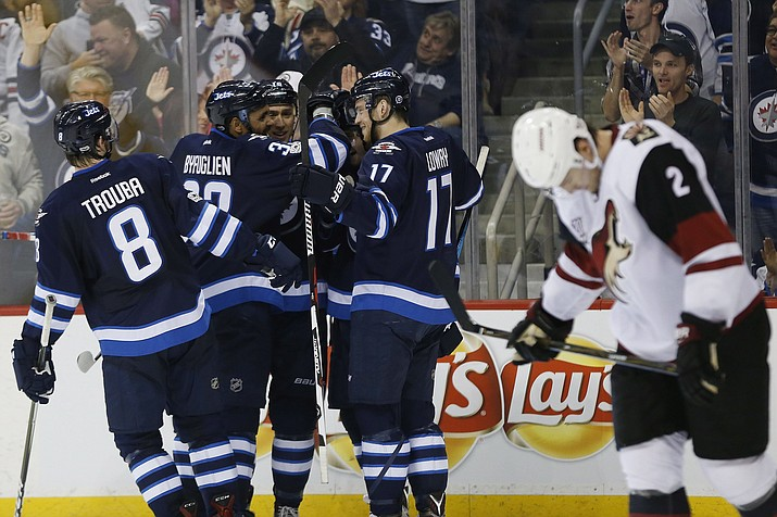 Winnipeg Jets' Jacob Trouba (8), Dustin Byfuglien (33), Shawn Matthias (16), Joel Armia (40) and Adam during the second period Wednesday night in Winnipeg, Manitoba. (John Woods/The Canadian Press, via AP)