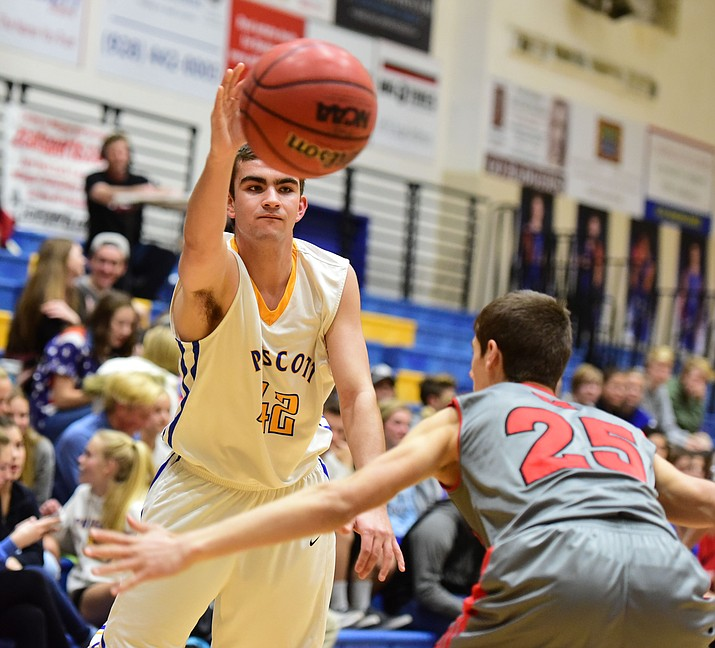 Prescott's Cameron Parsons passes the ball around a Mingus defender Tuesday, Jan. 17. The Marauders won 69-44. (Les Stukenberg/The Daily Courier)