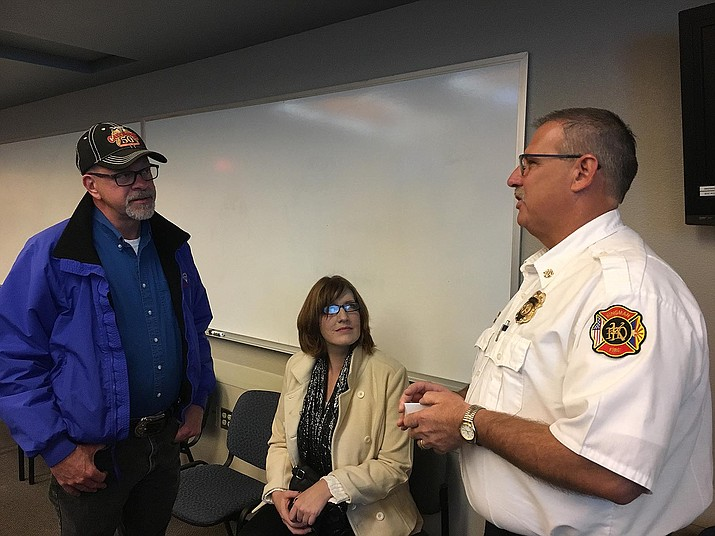 Keith Eaton, assistant fire chief of Kingman Fire Department, talks with real estate agent Dwayne Patterson Thursday about changes coming to city of Kingman's building department.