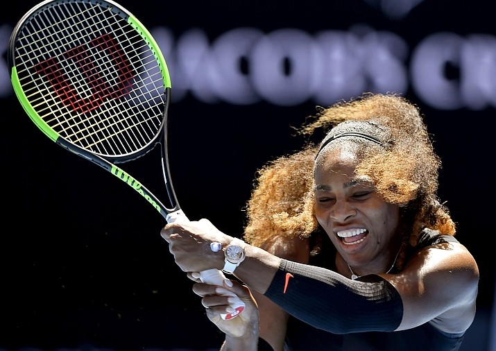 United States' Serena Williams hits a backhand return to compatriot Nicole Gibbs during their third round match at the Australian Open on Saturday in Melbourne, Australia. (Andy Brownbill/Associated Press)