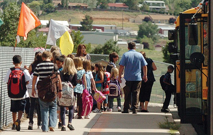 Students make their way to the buses at Coyote Springs Elementary School, after the first day of school in Prescott Valley in this 2010 file photo. A recent study reports that boys are bullied on school buses more than girls.