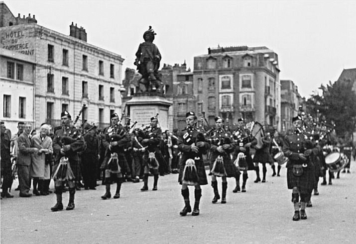 The Essex Scottish and its pipe band enter Dieppe, France, with the forward-sweeping Canadian Army. The Dieppe raid saw the Essex Scottish take over 500 men to France and only 51 made it out to return back to England.