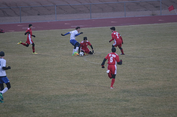 Kingman Bulldogs' Chandler Baca makes a move during Friday afternoon's game against River Valley. Baca scored both goals in the pivotal 3A Region 6 match.