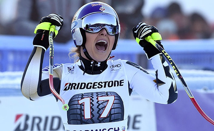United States' Lindsey Vonn celebrates after completing an alpine ski, women's World Cup downhill, in Germany, Saturday, Jan. 21.