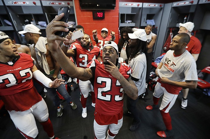 Atlanta Falcons' Robert Alford takes a selflie after his team defeated Green Bay Sunday, Jan. 22, 2017, in Atlanta.