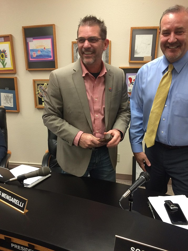 Greg Mengarelli, left, takes over the leadership of the Prescott Unified School District at Jan. 10 meeting.  At right is his predecessor, Dr. Scott Hicks.