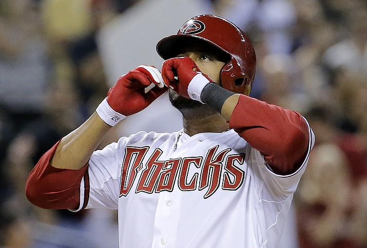In this Thursday, July 31, 2014, file photo, Arizona Diamondbacks' Andy Marte celebrates his two run home run against the Pittsburgh Pirates during the sixth inning of a baseball game in Phoenix. Authorities in the Dominican Republic said, Sunday, Jan. 22, 2017, that Kansas City Royals pitcher Yordano Ventura and former major leaguer Marte died in separate traffic accidents.