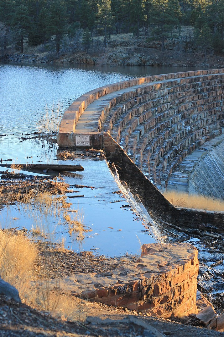 Sante Fe Dam is at capacity, with water flowing over the spillway Jan. 19.