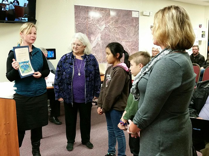 Grand Canyon fourth graders Jaemie Jensen and Rem Chenevert were recognized by the Coconino Plateau Watershed Partnership at the Jan. 18 Tusayan Town Council meeting.