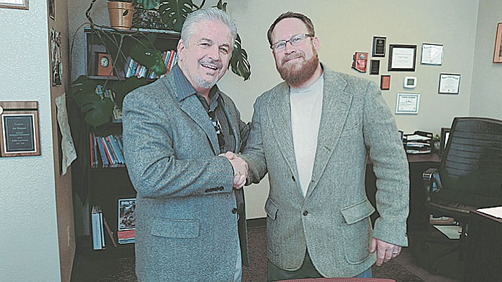 PUSD Superintendent Joe Howard (right) shakes hands with Commercial Properties Northern Arizona Principal Donald Teel, who worked with Ironline Partners LLC in Phoenix to broker this deal, and continues to negotiate with the developers on two more school properties expected to sell over the next couple months.