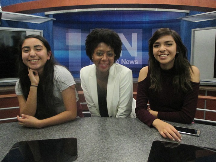 ASU student Saundra Wilson poses on a TV set with Hopi High's Elisa Casarez and Serena Leslie during a recent visit to the Crokite School of Journalism in Phoenix. Stan Bindell/NHO