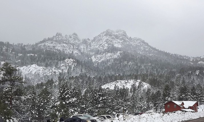 A cold, persistent rain pelted the city and surrounding area last weekend, but up in the Hualapai Mountains, it was snow that fell from the sky – and a lot of it, judging by this reader-submitted photograph.