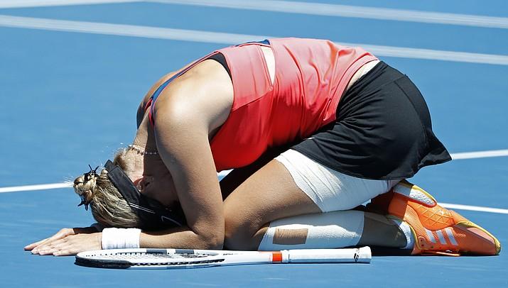 Croatia's Mirjana Lucic-Baroni celebrates after defeating Karolina Pliskova of the Czech Republic  during their quarterfinal at the Australian Open on Wednesday in Melbourne, Australia. (Dita Alangkara/Associated Press)