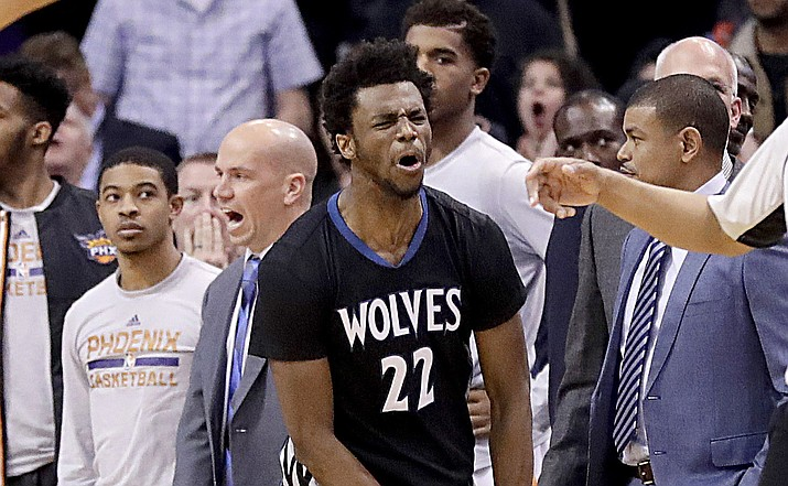 Minnesota Timberwolves forward Andrew Wiggins (22) reacts to making the game winning basket against the Phoenix Suns as time expires during the second half Tuesday, Jan. 24, in Phoenix. The Timberwolves won 112-111. (Matt York/Associated Press)