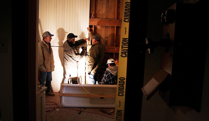 The Old Guys spent a recent cold, rainy Thursday morning renovating the kitchen of the Historic Hance House, located on Coppinger Street across from Fort Verde State Historic Park. (Photo by Bill Helm)